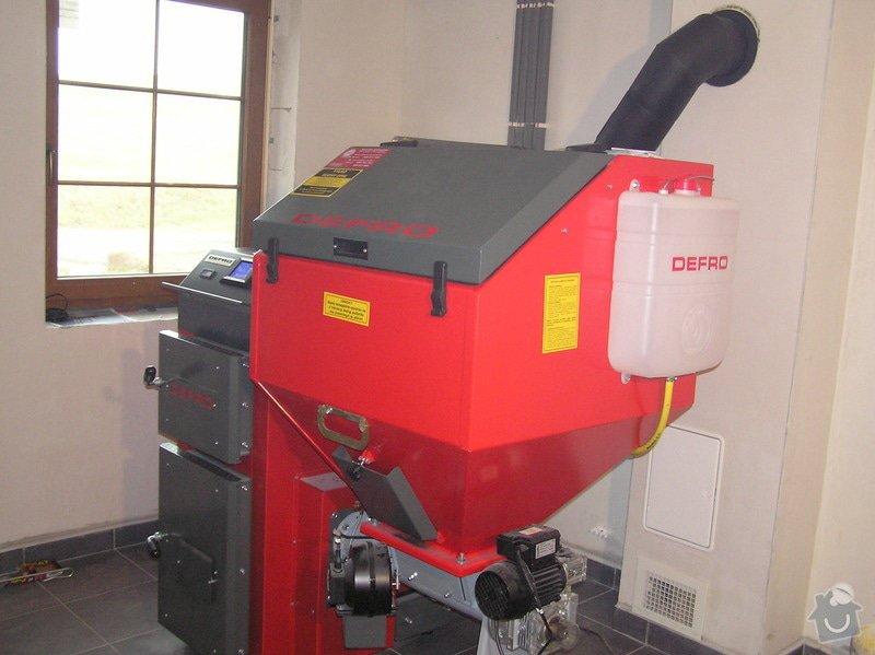 Instalace automatického kotle na tuhá paliva DEFRO AGRO Uni 15 kW v novostavbě RD: 024