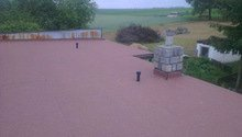 Zateplení ploché střechy foukanou izolací