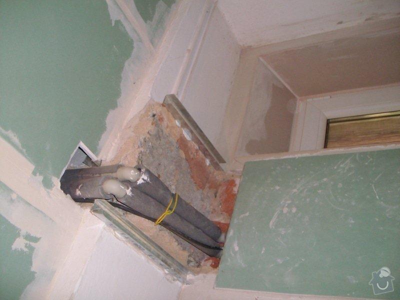 Obložení zděného sprch. koutu 1m2 do výšky cca 2m, vč. instalace sprch. baterie a odpadu,přesun el. zásuvek : 013