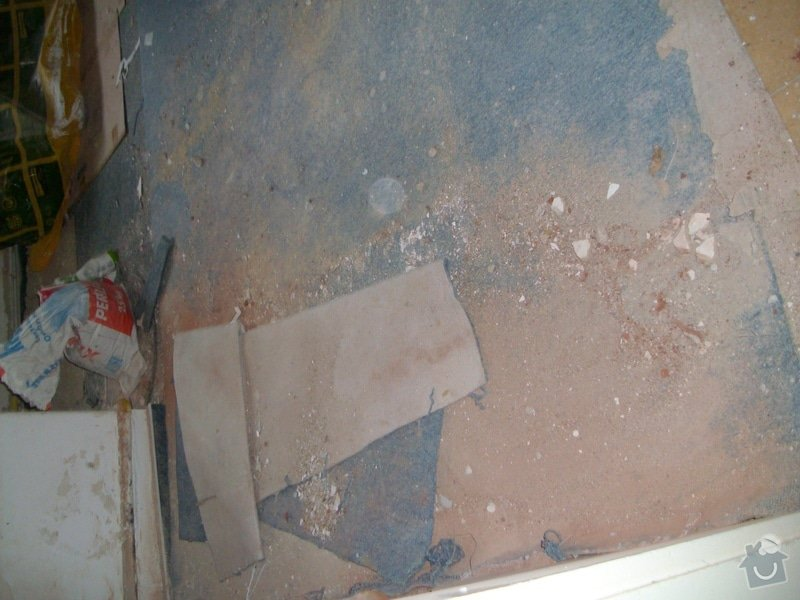 Obložení zděného sprch. koutu 1m2 do výšky cca 2m, vč. instalace sprch. baterie a odpadu,přesun el. zásuvek : 038