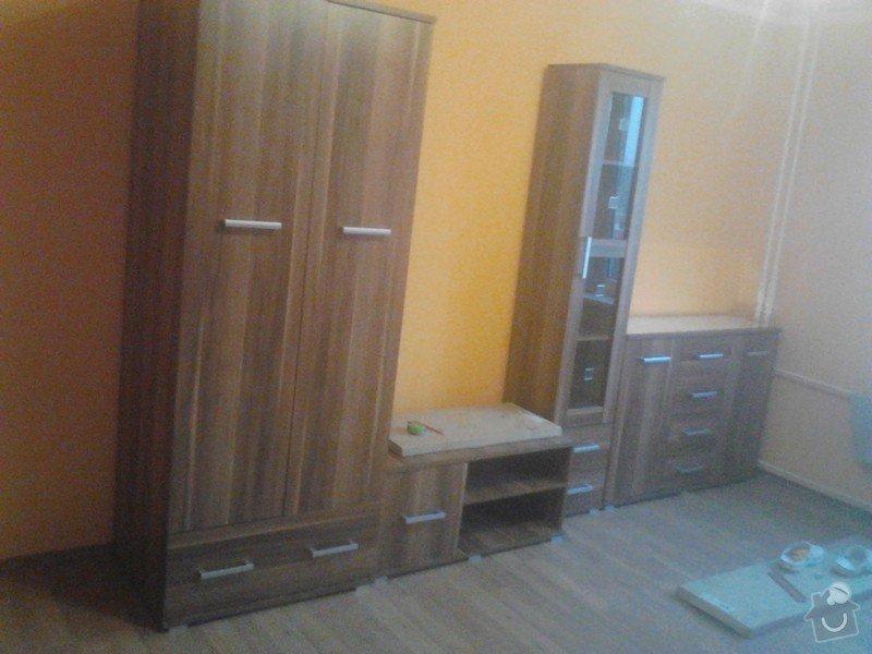 Rekonstrukce panelového bytu: montaz_nabytku_obyvaci_pokoj2