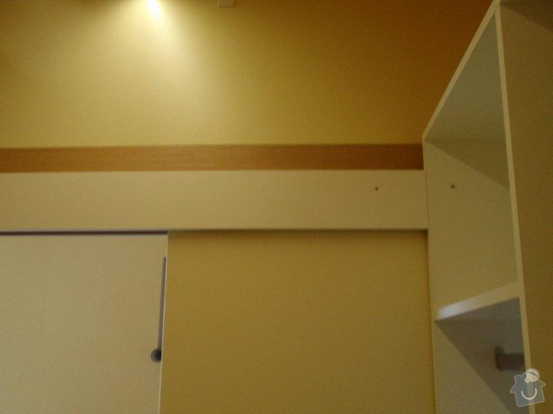Předělovací příčka + úložné prostory : 215