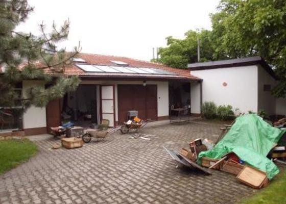 Přestavba garážové dílny na bytovou jednotku v RD