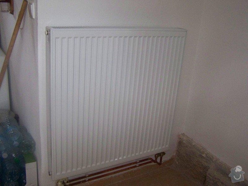 Topeni pro chalupu: radiator_v_kuchyni
