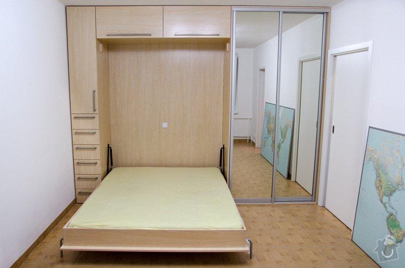 Kuchyňská linka a úložná skříň s vyklápěcí postelí a sedačkou. : 4-40